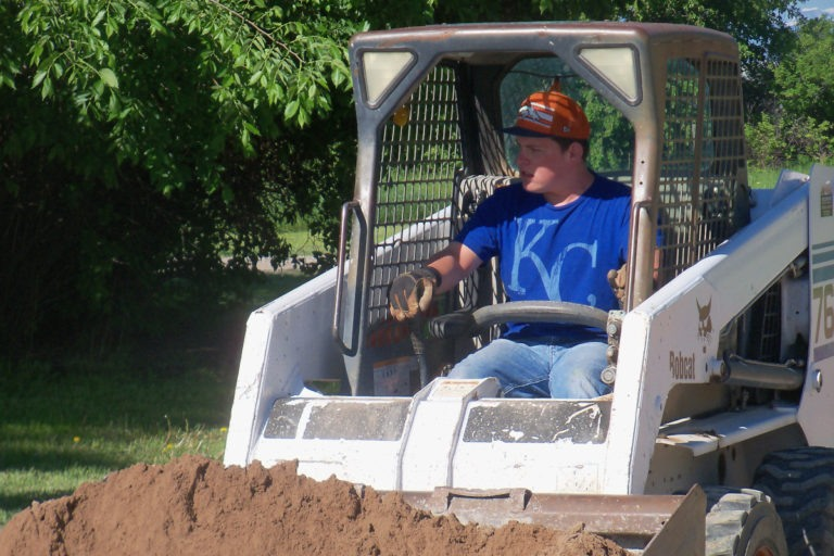 Luke regularly helps with projects around the farm.